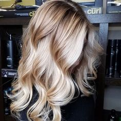 there is such a thing as the PERFECT blonde and this is it. every dimension comes together in luxurious flowing waves to show off its rich color