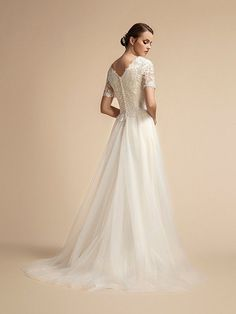 Moonlight Modesty is a flowing tulle A-line featuring a lace bodice and T-shirt length sleeves making for a charming style for an elegant bride. Beaded Wedding Gowns, Bridal Gowns, Lace Wedding, Wedding Dress Backs, Modest Wedding Dresses, Lace Sleeves, Dresses With Sleeves, Elegant Bride, Elegant Wedding