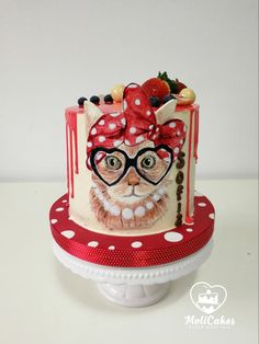 a cat wearing glasses by MOLI Cakes