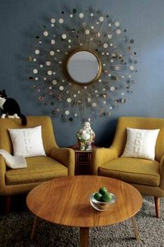 Vintage retro mid century hollywood regency living room with brass gold sunburst starburst mirror parker teak furniture