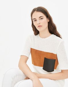 Sandro short-sleeved round neck top. Featuring a patch pocket in a contrasting colour on the side and a denim strip across the chest. Concealed zip closure at the back. To wear with jeans for a casual-chic look. The model is wearing a size 1.