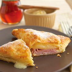 Baked Monte Cristo Sandwich - Set aside the bread and serve this ham and cheese melt on puff pastry instead. Sweet and savory never tasted so good.especially when topped with a sprinkle of confectioners' sugar. Think Food, I Love Food, Good Food, Yummy Food, Yummy Lunch, Monte Cristo Sandwich, Pepperidge Farm Puff Pastry, Great Recipes, Favorite Recipes