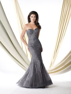 Strapless illusion mermaid gown encrusted with hand-beading, sweetheart neckline, dramatic hemline with sweep train, suitable for wedding guests, formal events and cocktail parties. Matching shawl and removable straps included. Sizes: 4 – 20
