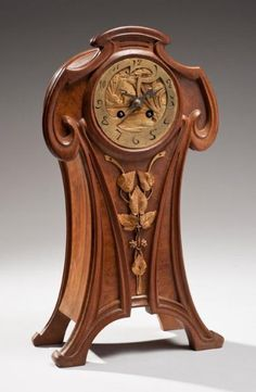 Maurice Dufrène, Mantel Clock. Carved Mahogany with Gilt Bronze Mounts  France. Circa 1900.