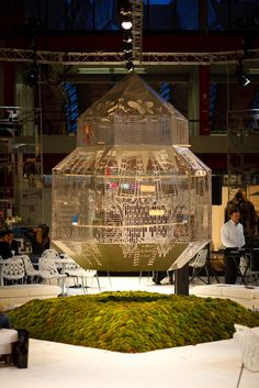 JSPR impressive light installation the Caged Beauty at Modefabriek Amsterdam. A bird cage with actual birds inside!