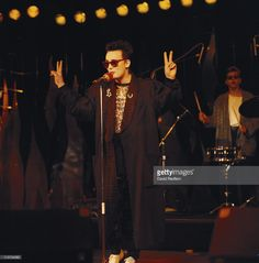 Culture Club singer Boy George holding up both hands held in the V sign peace symbol while singing into a microphone on stage during a live concert performance circa Jon Moss the band's drummer can be seen in the background behind Boy George. Culture Club, Boy George, Vintage Music, Music Icon, Stock Pictures, To My Future Husband, Cool Bands, Holding Hands, Georgia
