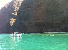 Snorkeling in the clear waters off the Napali Coast, Kauai, HI