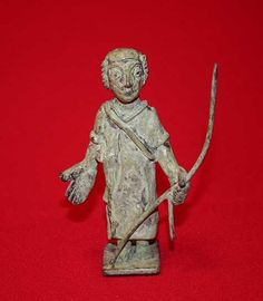 Guerrero con manto y lanza rota. Exvoto Ibérico. (12 x 4 x 14 cms)
