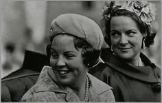 Princess Beatrix and Princess Irene ride through Amsterdam, 1962.