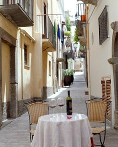 "Dining alfresco - Often found in many European Cities in their ""Old Town' corridors"
