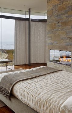 Gorgeous fireplace and view of the ocean