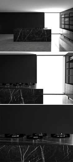 Monolith from piqu a contemporary stone kitchen island shown here in Nero Marquinas marble with matching shelving unit and Pitt burners directly fitted to the worksurface.