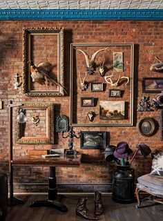"""The loft still has its original tin ceiling, abundantly patched, and lots of """"happy"""" taxidermy and thrift store artwork."""