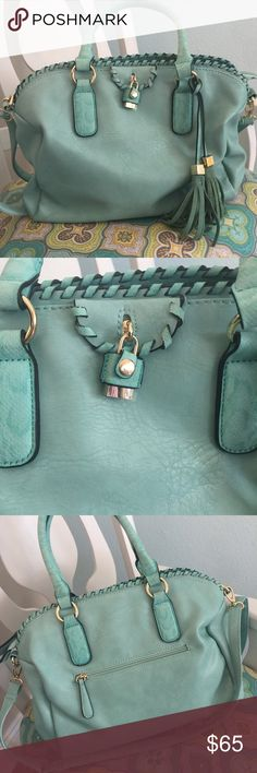Tassle Turquoise Handbag Beautiful leather handbag in a lovely turquoise color😍 suede tassle fringe accent! Gold tone accent! Fully lined inside bag. Open with two pockets, one is phone or glasses size storage. Large pocket with zipper. Zipper access. 15x11in. Bags Satchels