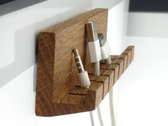 Great solution for your laptop cables, USB cords and gadget chargers not to get tangled or fall behind your desk, or just go missing!!! Fixed well to the wall or desk, it holds the phone nicely that makes it even more convenient to use. This is a very simple, yet stylish, space-optimizing cable holder. Handmade from natural oak tree, it is custom handcrafted to perfection. It features 7 easy-slide slots and can be displayed horizontally or vertically, on your desktop or beside. Lightweight…