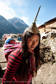 Mother and baby . Bhutan A Layap girl and her baby in the remote village of Laya  Laya, Gasa District, Bhutan