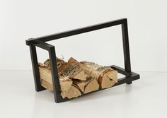 Hanna Särökaari and Elina Ulvio collaborated on the multifunctional Woodi storage rack which is designed to hold your firewood, books, or even magazines. Metal Furniture, Furniture Design, Nordic Chic, Wood Rack, Firewood Storage, Scandinavian Furniture, Office Accessories, Chair Design, My Design