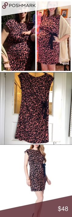 Taylor Maternity Dress Coral & Navy side tie Perfectly adorable cap sleeve dress from Taylor, purchased at A Pea in the Pod. Beautiful Navy & Coral print with a cute ribbon tie on the side. Very flattering and forgiving for your growing bump! Wore this only once to my baby shower! EUC A Pea in the Pod Dresses