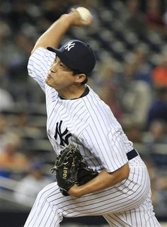 GAME 57: Friday, June 8, 2012 - New York Yankees' Ryota Igarashi, of Japan delivers a pitch during the ninth inning of an interleague baseball game against the New York Mets in New York. The Yankees won 9-1. (AP Photo/Frank Franklin II)