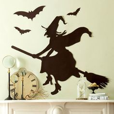 Wickedly Fun Witch Decorations for Halloween.Cast a spell on your home -- both inside and out -- this Halloween with these bewitchingly good ideas for spooky witch decorations. Witch and Bat Silhouettes Mantel Diy Halloween, Entree Halloween, Halloween Witch Decorations, Adornos Halloween, Halloween Mantel, Halloween Party Themes, Holidays Halloween, Happy Halloween, Halloween House