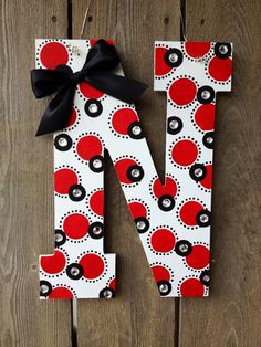 "Hand-painted 13.5"" wood Nebraska Husker N, red, black, and white with polka dots, rhinestones, and black bow"
