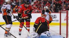 Flames collapse ends in OT loss Ducks take series stranglehold