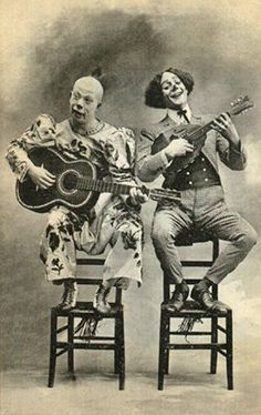 roll up circus x factor and pop idol contestanrts the guitar and uke playing dou of clowns fester and mo. Circo Steampunk, Steampunk Circus, Cat Costumes, Halloween Costumes, Carnival Costumes, Scary Carnival, Vintage Photographs, Vintage Photos, Creepy Old Photos