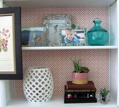 """fabric on the back of the bookshelf to make it """"pretty"""" it up"""