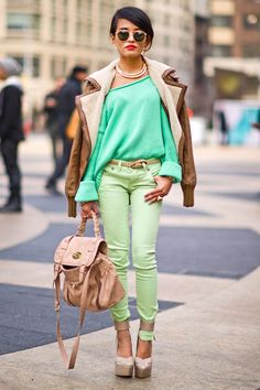 Olivia Lopez wears an ASOS jacket, Acne sweater, Max Azria shoes, Mulberry bag, and Givenchy collar.