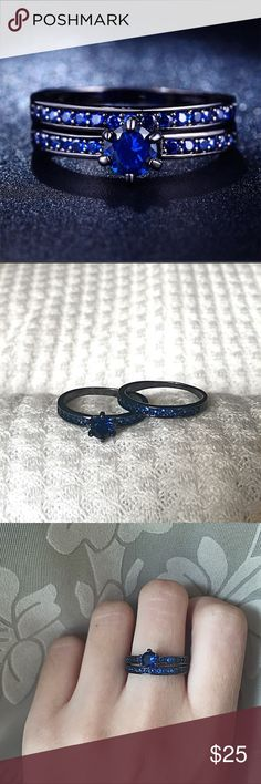 2 Blue Stone Black Rhodium Band Rings Brand new Price firm No trades Ring box included          Metal: Stainless Steel     Stone Color : Blue Cubic Zirconia     Stones: Cubic Zirconia     Finish: Black Rhodium Plated     Carat weight main stone: 1.00ct     Total Carat Weight: 1.90ct     Cut: Round Brilliant  Will not turn finger green Jewelry Rings