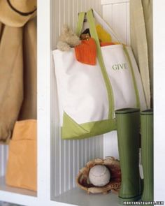 Donations Bag - Hang a sturdy, extra-large tote bag in a central location or by the back door and let it serve as a collection bin for clothes, housewares, toys, and other items that you decide to give away. When the bag is full, simply grab the handles and take the contents to a local charity.