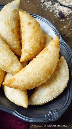 Goan Neureos are deep-fried, flaky pastry stuffed with coconut & dried fruit filling. They are also known as Karanji in Maharashtra, sweet Somas in Tamil Nadu, Gujiya or Ghughra in North India. Somas usually also include gram dal, and Gujiyas have Indian Dessert Recipes, Sweets Recipes, Snack Recipes, Cooking Recipes, Snacks, Indian Sweets, Diwali Recipes, Dishes Recipes, Indian Recipes