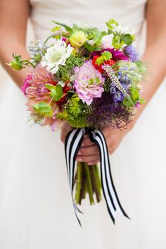 Bright wildflower bouquet tied with a striped ribbon: http://www.stylemepretty.com/california-weddings/2014/10/06/whimsical-diy-wedding-with-pizzaz-at-the-memory-garden/ | Photography: Sorella Muse - http://www.sorella-muse.com/