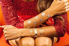First thoughts that come to mind with temporary tattoos are summer and music festivals.  But it doesn't have to be that way!  You can rock these artistic, weightless accessories anytime of the year thanks to clever shops making it happen.  LimeLight's holiday collection (above) includes poinsettias, hollies, snowflakes, and candy cane ropes.