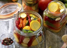 Preparing preserves of pickled zucchini, pepper and tomatoes in jars with spices, garlic and herbs with selective focus Chutney, Bananas, Canned Squash, Fall Recipes, Healthy Recipes, Healthy Meals, Canning Peaches, Dried Peppers, Using A Pressure Cooker