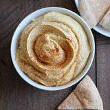 Easy hummus without tahini that requires just one bowl, 8-ingredients, and 5 minutes to make! This is the best hummus ever!