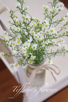 Cute rustic pew end hanging jars with white easter daisies, designed by Tiffany's flowers.