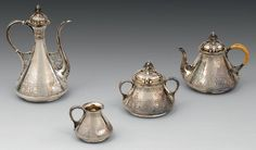 """Silver tea service comprising 2 teapots, covered sugar bowl and creamer on pedestals; the body decorated with swags, staples and concentric patterns on matt background; lids and apply stylized shells engraved lancets, catches seeds held by foliage supports, handles to """"snake skin"""" (except the small teapot handle clissée) pattern. Emile Froment-Meurice by punch Minerva (after 1865)."""
