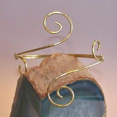 This armband will be created just for you using thick 14 gauge, hammered brass, bronze or copper. The swirls span over 2 inches. Absolutely stunning with any attire. This armlet will be hand-made to order just for you. Please be sure to select your desired size in available options, or