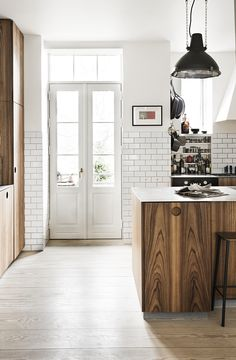Beautiful kitchen with wood, tiles and great decorating ideas.