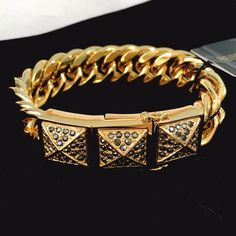 Rebecca Minkoff Pavé Pyramid Gold Bracelet Solid chain bravely accented by three pyramids studded with grey rhinestones. Gorgeous piece, makes a statement! Clasp is magnetic, held by twin closures. Absolutely perfect condition, no flaws! Rebecca Minkoff Jewelry Bracelets