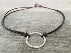Hammered Sterling Eternity Circle / Leather and Pearls Necklace  This symbol speaks to me. It reminds me of humility , faith and perseverance. Lets