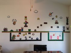 Super Mario themed wall done in perler beads and painted cork board
