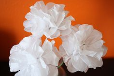 Tissue paper flowers...reminds me of a cousin's wedding getaway car!