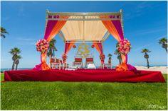 The bride made the Ganeshji backdrop. Beautiful beachfront mandap in Santa Barbara for an Indian wedding followed by a Christian ceremony. Photography: Randery Imagery www.shaadishop.co