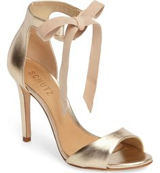 A soft tie at the ankle strap lends flirty movement to this sleek stiletto sandal.