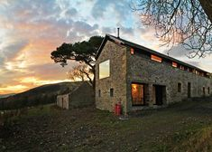 Scottish holiday home by WT Architecture masquerades as an old stone mill.