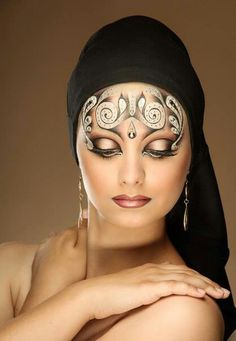Creative and artistic fantasy makeup with crystal accents.