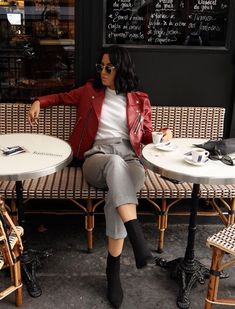 LA Blogger Tania Sarin in Paris during PFW wearing coach red leather and heeled boot heels.