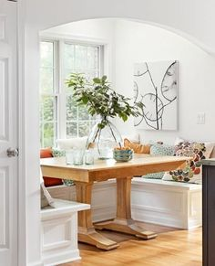 Kitchen banquette: A bumped-out alcove keeps a banquette away from a kitchen's workspace. More ideas for kitchen banquettes: http://www.midwestliving.com/homes/decorating-ideas/6-ideas-for-kitchen-banquettes/?page=2